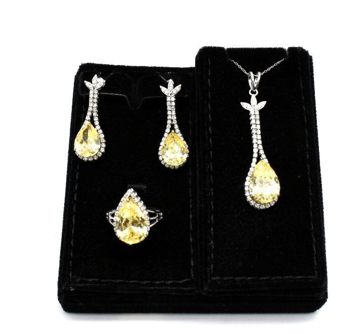 نص طقم الماس بحجر اصفر