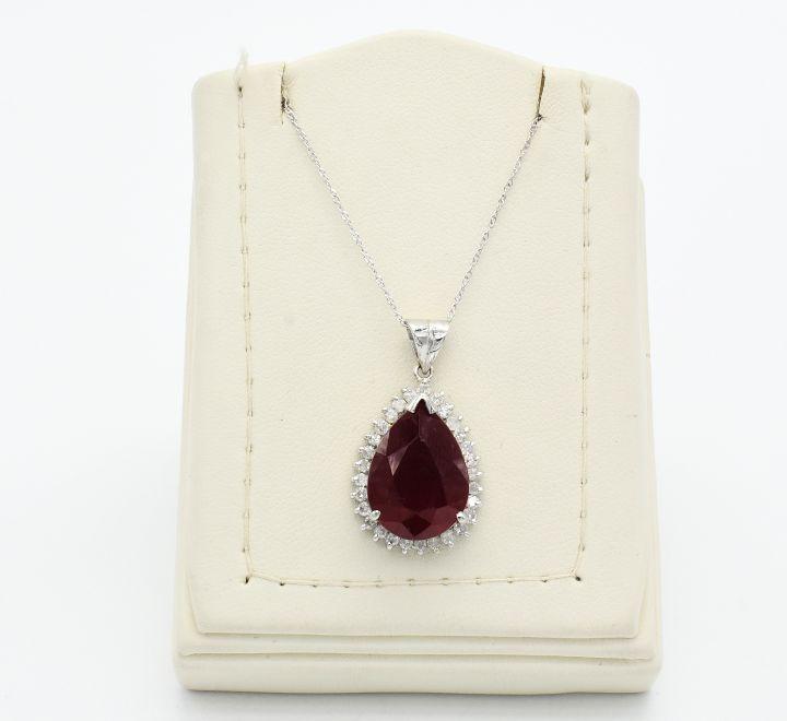 عقد الماس بحجر احمر صناعي